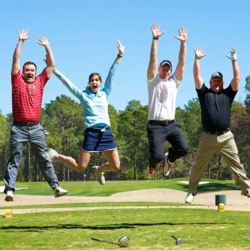 A group of golfers jump for joy at Lake Bluff Golf Club in Lake Bluff, Illinois